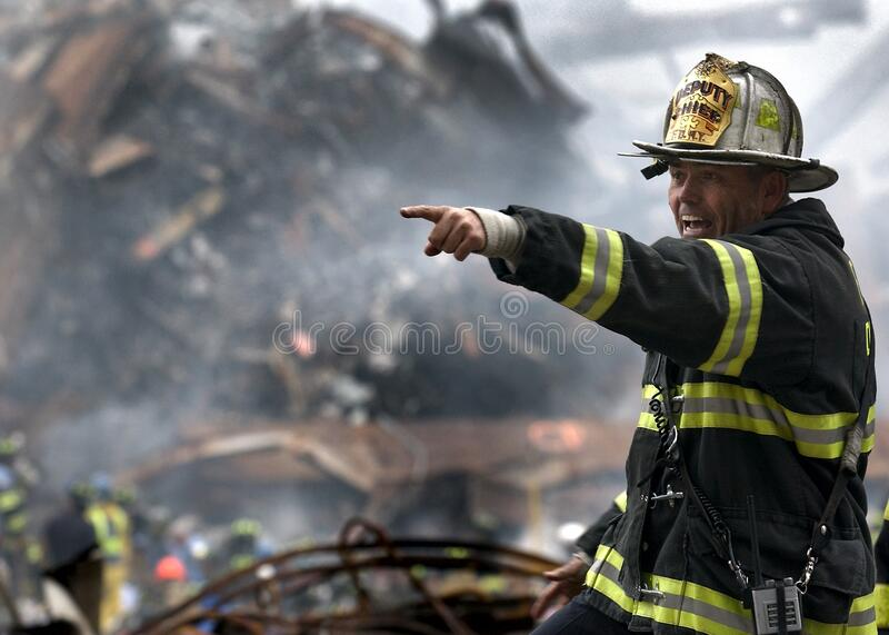 Fire Fighter Wearing Black And Yellow Uniform Pointing For Something Free Public Domain Cc0 Image