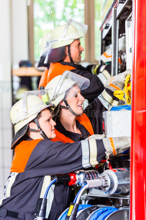 Free Fire Fighters Attaching Hose At Hose Laying Vehicle Stock Image - 78791141