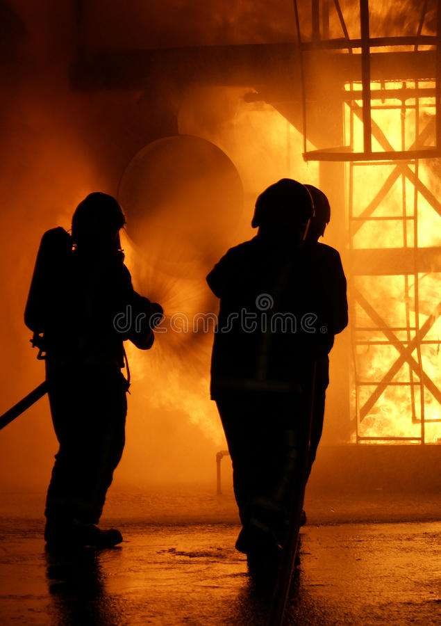 Fire-fighters at blaze. Fire-fighters at large balze royalty free stock images