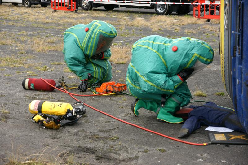 Fire fighters. At chemical incident in PPE stock images