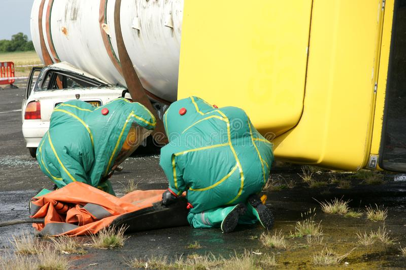 Fire fighters. At chemical incident in PPE royalty free stock photo