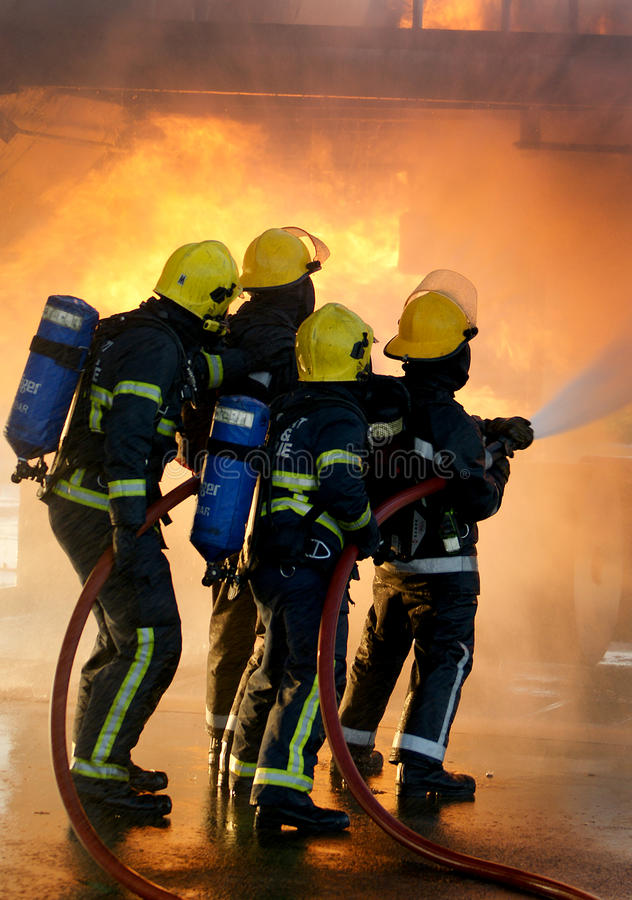 Fire-fighters an incident. Fire-fighters fighting fire in full BA stock photography