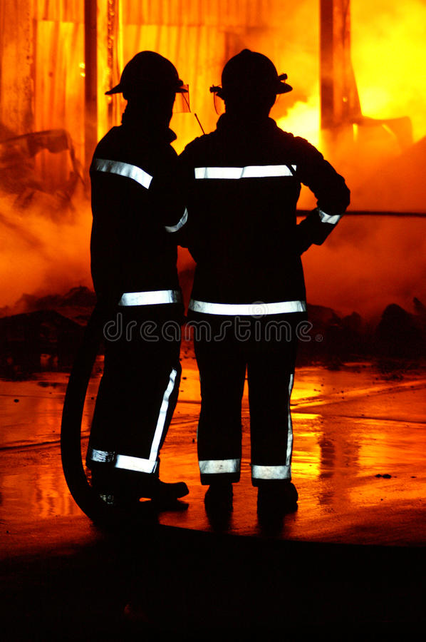 Fire fighters at incident. Fire fighters at large industrial fire stock photos