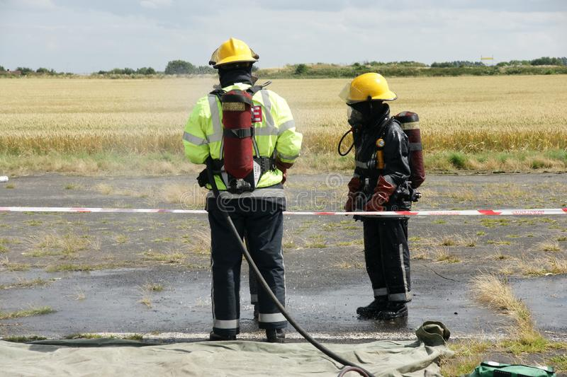 Fire fighters. At incident in PPE royalty free stock image