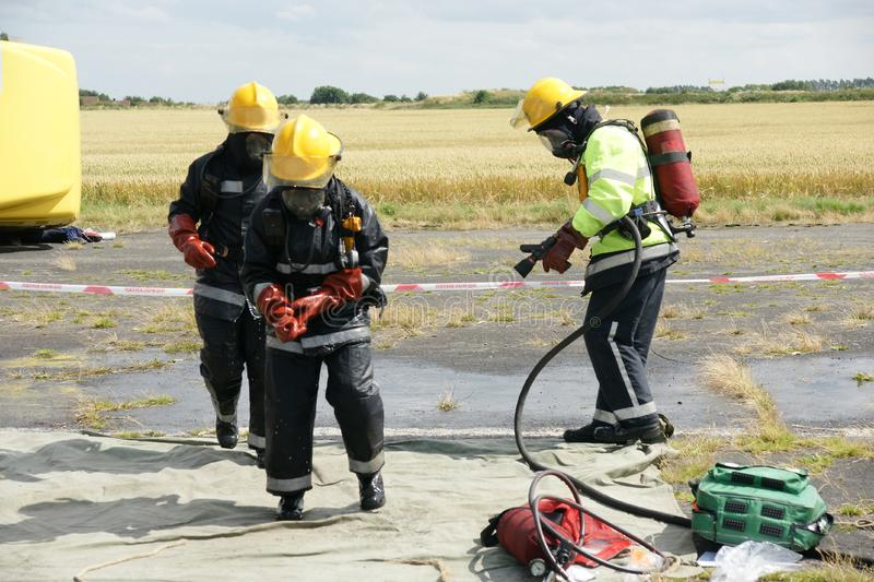 Fire fighters. At incident in PPE royalty free stock photo
