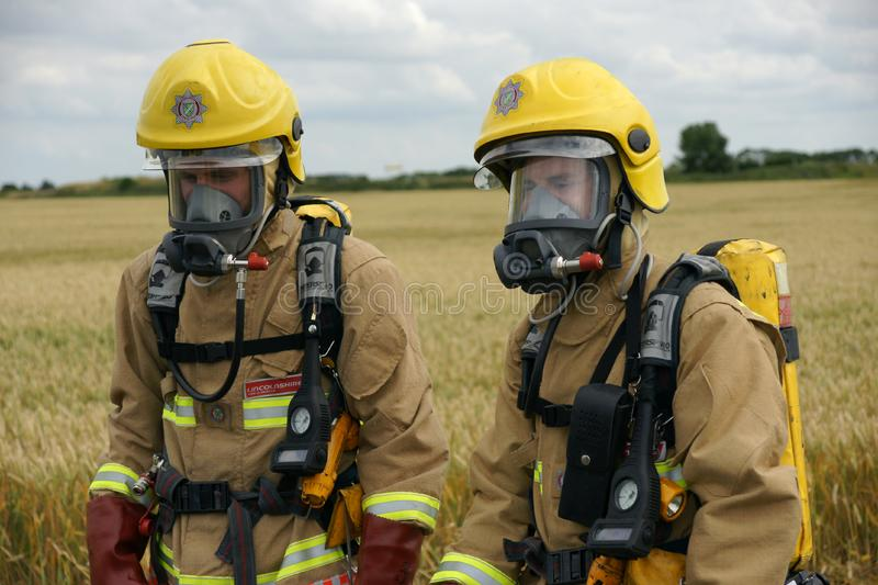 Fire fighters. At incident in PPE royalty free stock photography