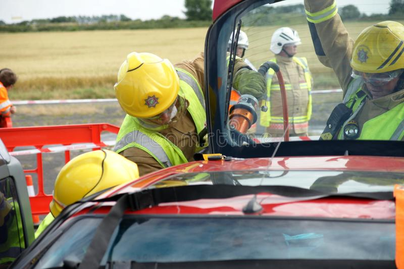 Fire fighters. At road traffic incident in PPE royalty free stock photography