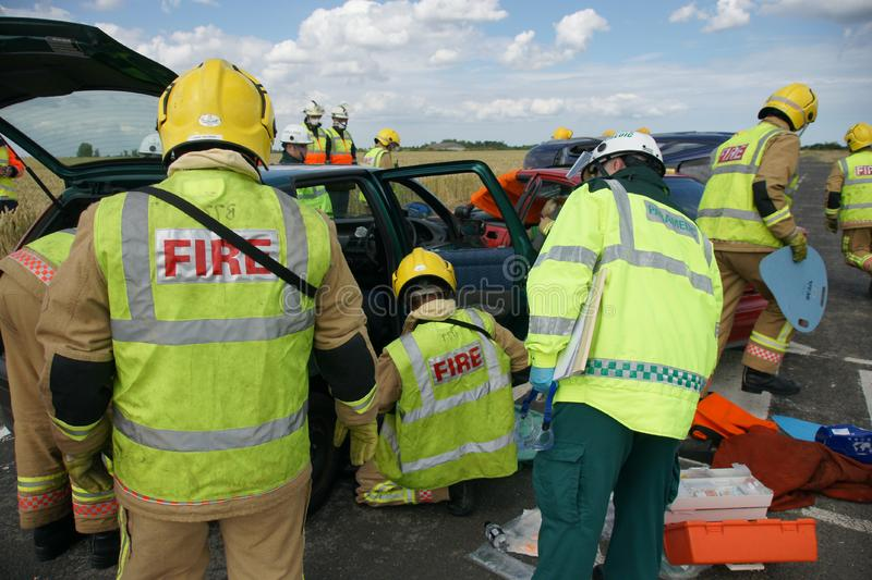 Fire fighters. At road traffic incident in PPE stock photography
