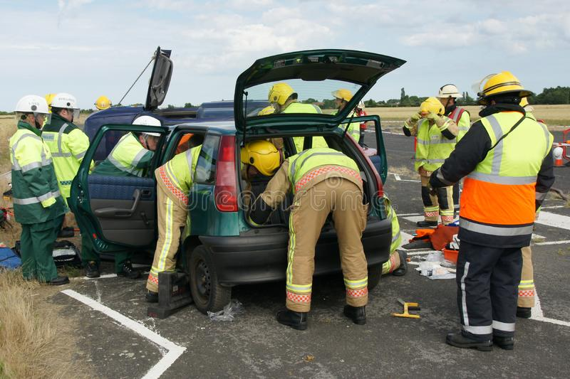 Fire fighters. At road traffic incident in PPE stock images