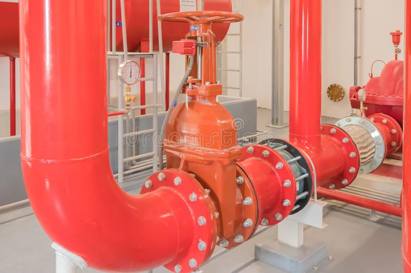 Fire fire fighting pining install with high performance gate valve in fire pump room. With gate valve stock photo
