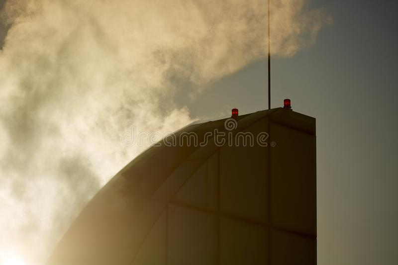 Fire and fire alarm. Building on fire and device alarming royalty free stock images