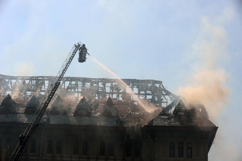 Fire. Fighters douse a  in an old building stock photography