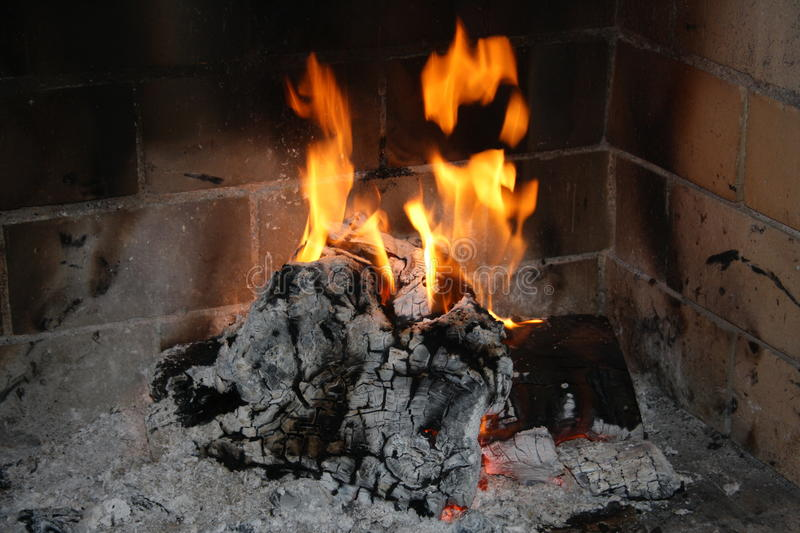 Fire in fireplace. In House stock photography