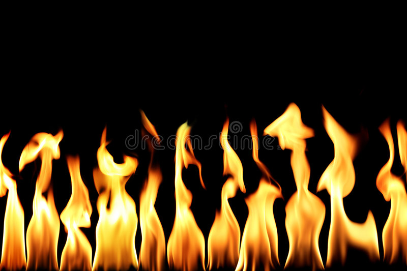 Fire flame. Conceptual orange fire flame in black background royalty free stock images