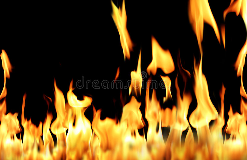 Fire flame. Conceptual orange fire flame in black background stock image