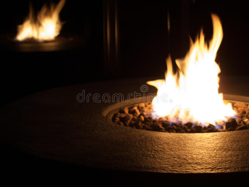 Fire flame in a coal fire pit stock images