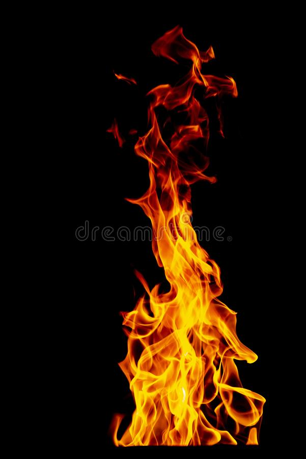 Fire flame isolated on black isolated background - Beautiful yellow, orange and red and red blaze fire flame texture style stock image