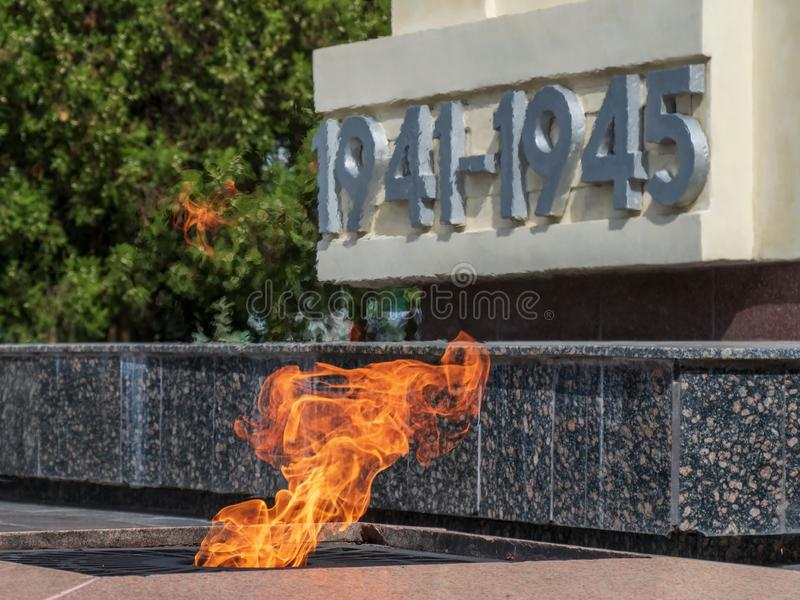 Fire flame symbol memory event monument monument town city street background traffic motor transport flames heat temperature tempe royalty free stock photo