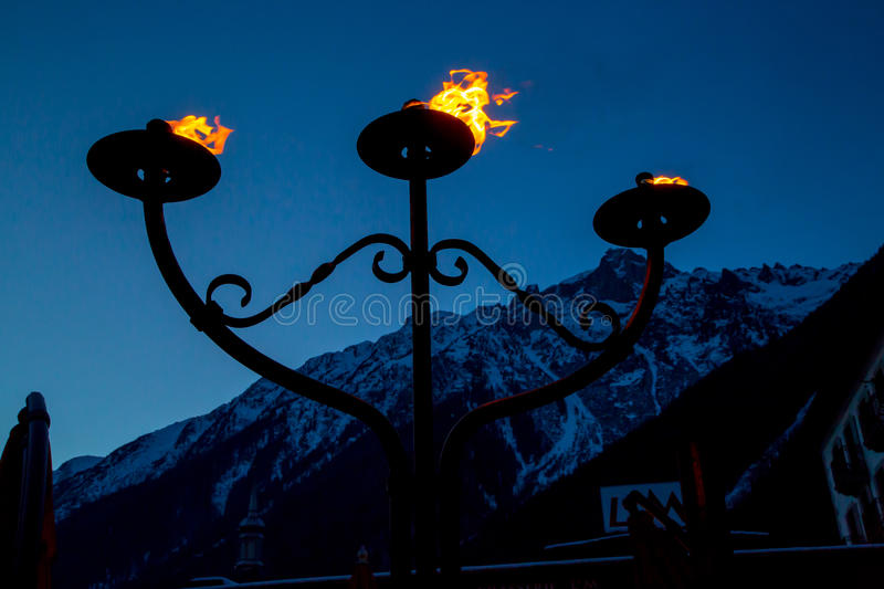 Fire and flame of three torches burning. Fire and flame of the three torches burning in the night at mountains stock photography