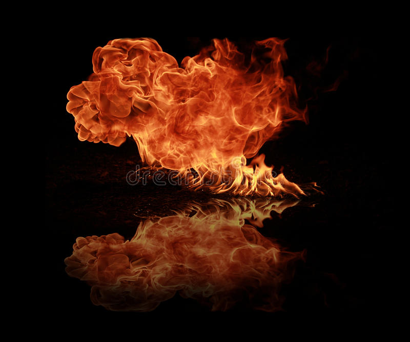 Fire flames. Isolated on black background stock photos