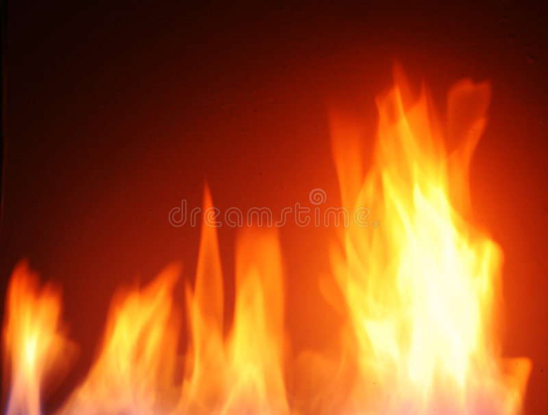 Fire flames. Over black background stock photos
