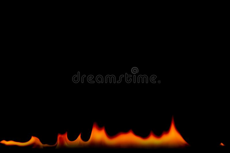 Fire flames on Abstract art black background, Burning red hot sparks rise. Fiery orange glowing flying particles royalty free stock image