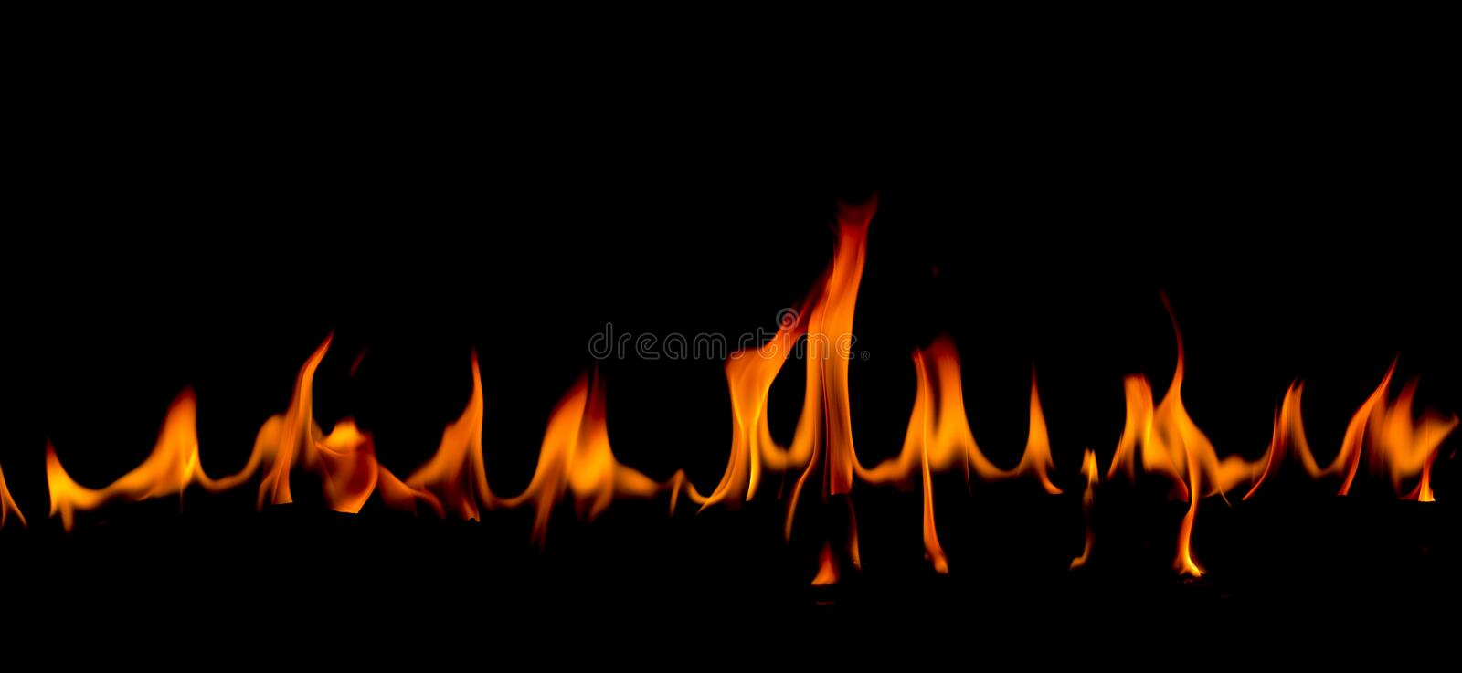 Fire flames on Abstract art black background, Burning red hot sparks rise. Fiery orange glowing flying particles stock image