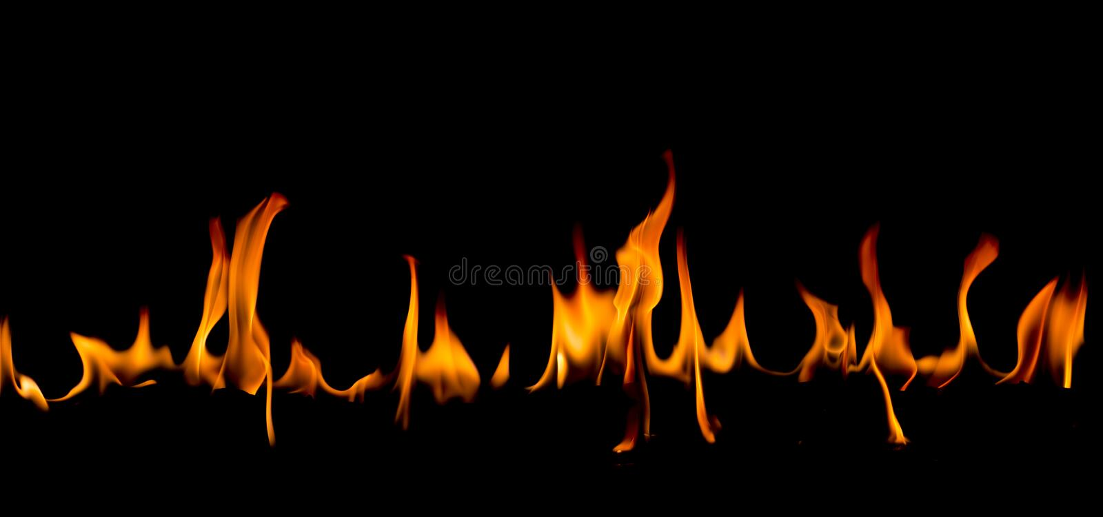 Fire flames on Abstract art black background, Burning red hot sparks rise. Fiery orange glowing flying particles stock photos