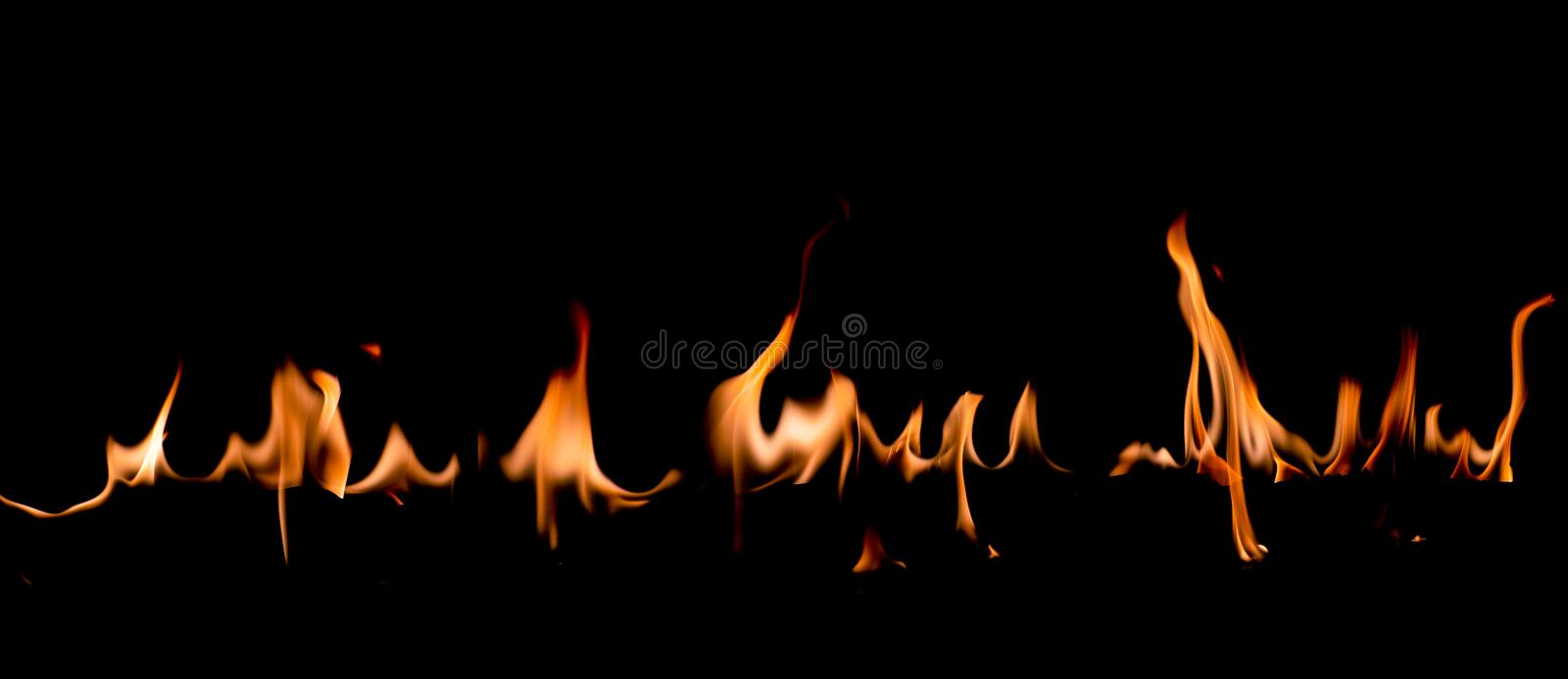Fire flames on Abstract art black background, Burning red hot sparks rise. Fiery orange glowing flying particles stock photography