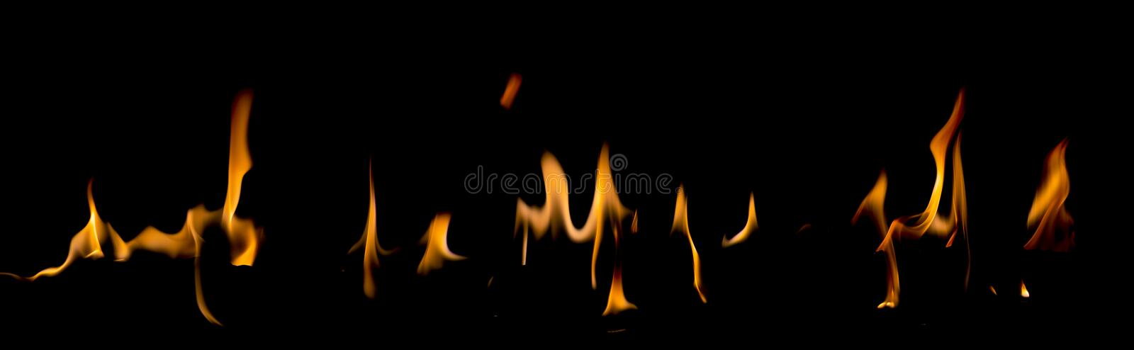 Fire flames on Abstract art black background, Burning red hot sparks rise. Fiery orange glowing flying particles stock photo