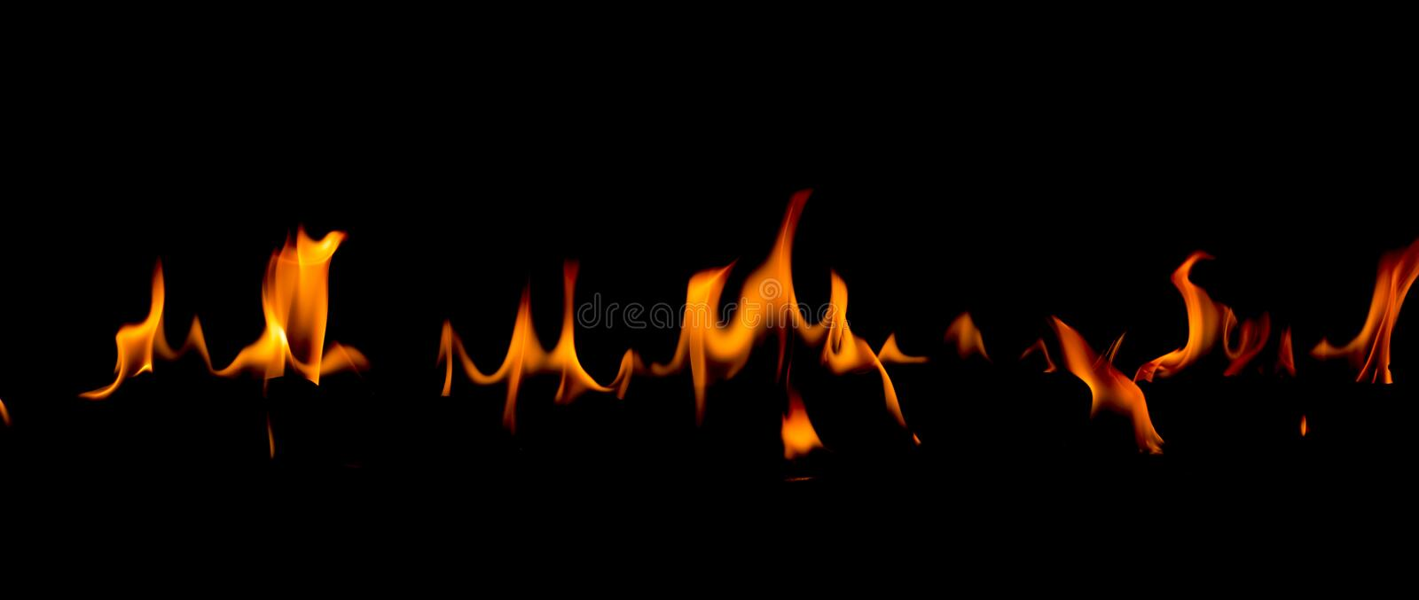Fire flames on Abstract art black background, Burning red hot sparks rise. Fiery orange glowing flying particles royalty free stock photography