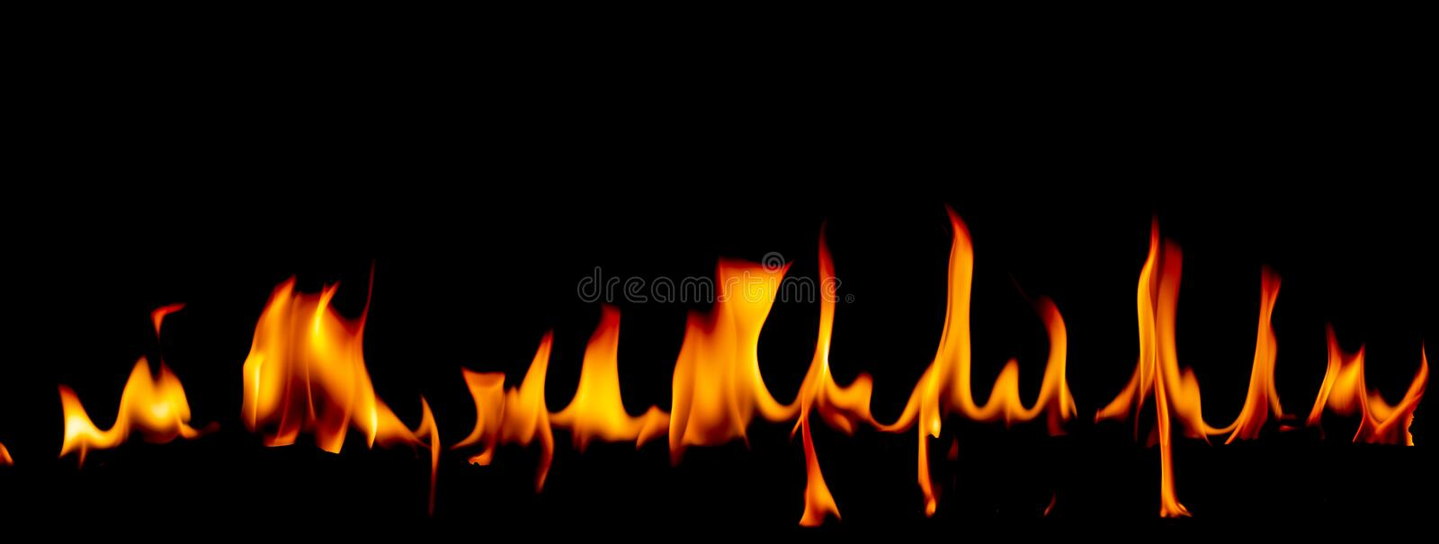 Fire flames on Abstract art black background, Burning red hot sparks rise. Fiery orange glowing flying particles royalty free stock photo