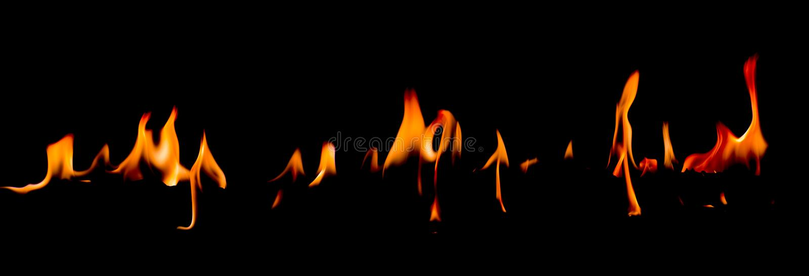 Fire flames on Abstract art black background, Burning red hot sparks rise. Fiery orange glowing flying particles royalty free stock images