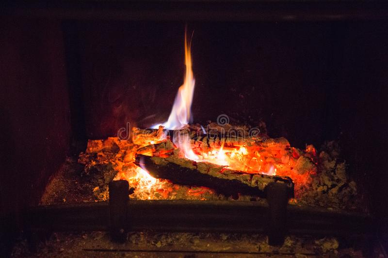 Fire flames with ash in fireplace. Background, orange royalty free stock image