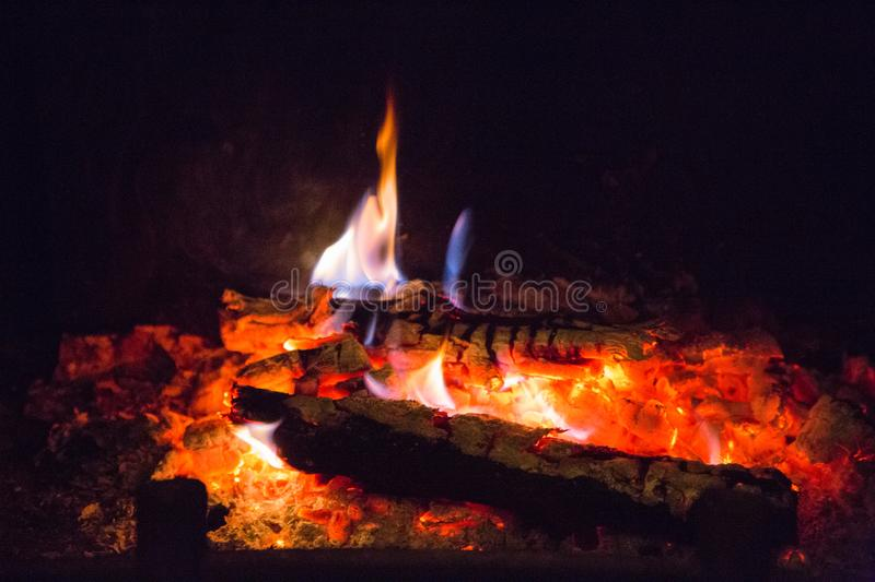 Fire flames with ash in fireplace. Background, orange stock photo