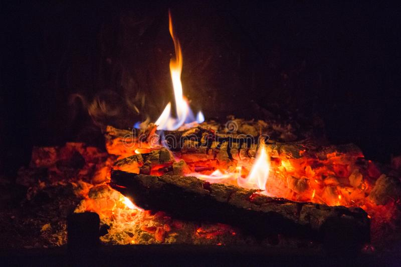 Fire flames with ash in fireplace. Background, orange stock image