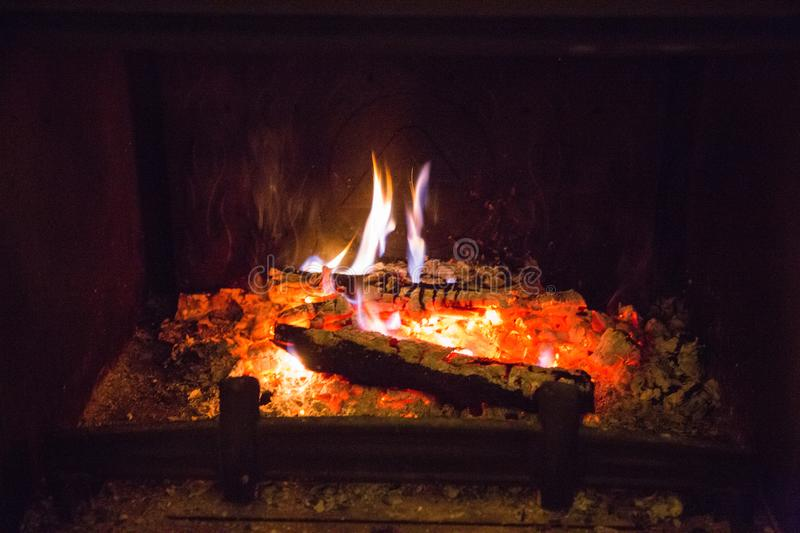 Fire flames with ash in fireplace royalty free stock photo