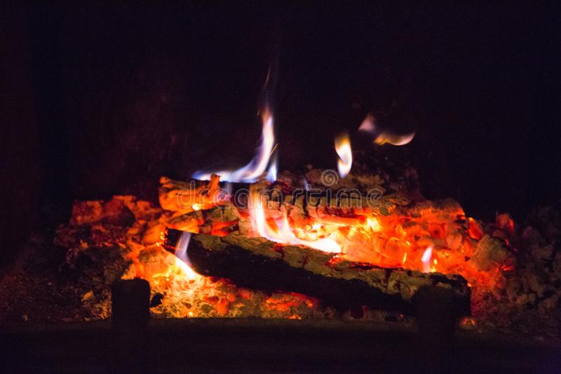 Fire flames with ash in fireplace royalty free stock photography