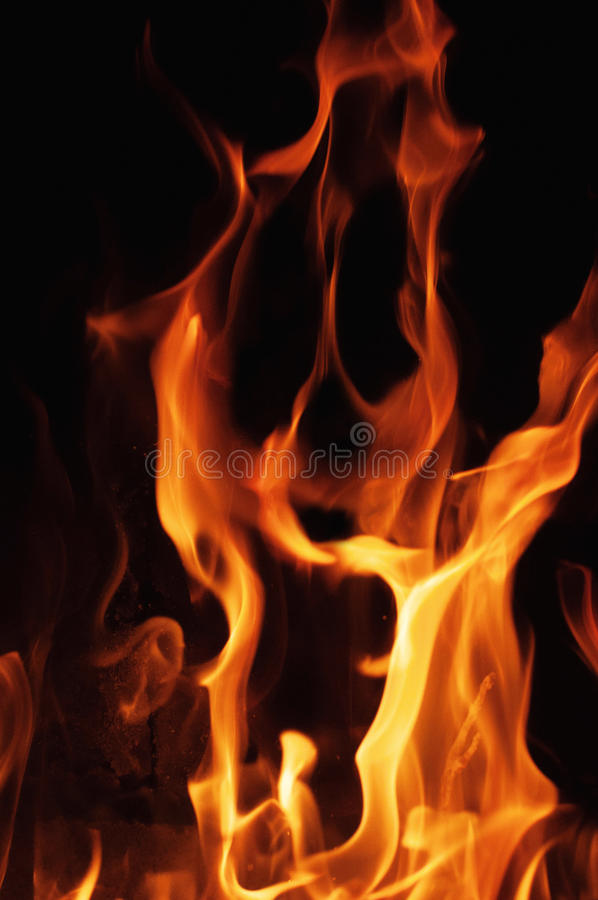 Fire flames on a black background. Blaze fire flame texture background. Close up of fire flames isolated on black background. Burn stock photo