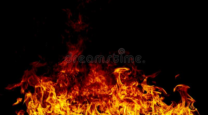 Fire flames on a black stock photos