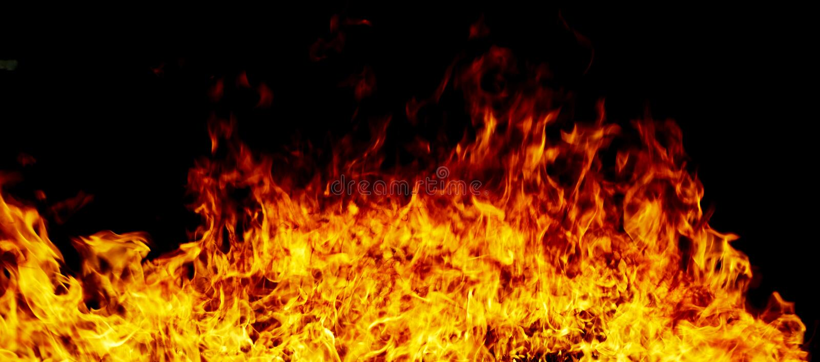Fire flames on a black stock image