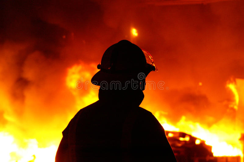 Fire fighter. Fire and flames, fire-fighter at incident royalty free stock photo