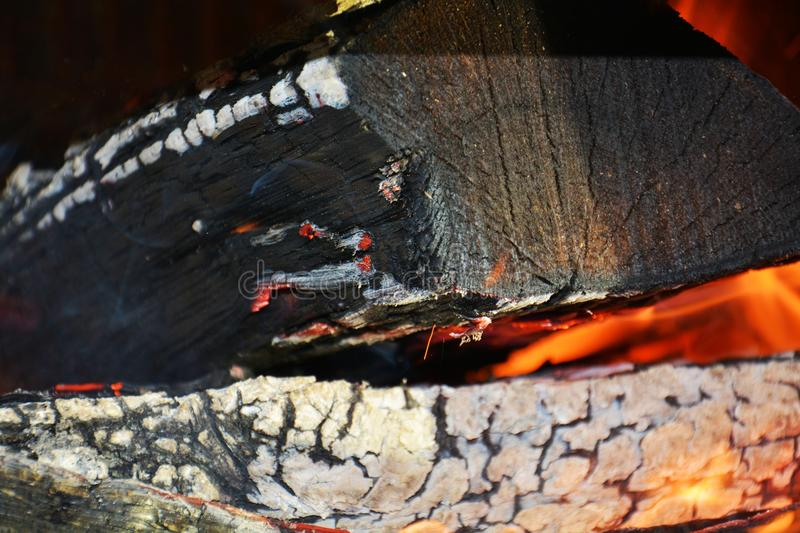 Fire, flames and oven. Wood dark hard logs burning, orange flames and hot temperature stock photos