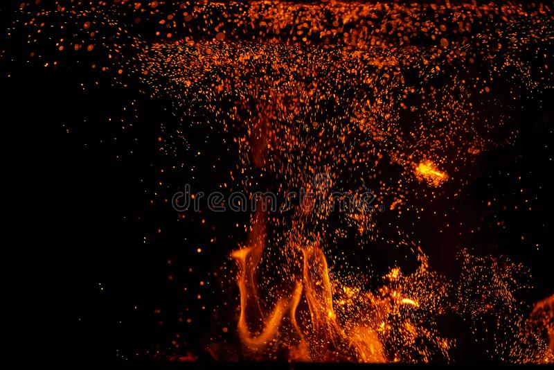 Fire flames and sparks on black background stock photos