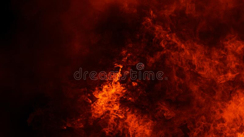 Fire flames texture on isolated black background. Perfect texture overlays for copy space. Design element. Fire flames texture on isolated black background stock photography