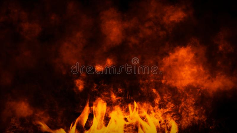 Fire flames texture on isolated black background. Perfect texture overlays for copy space. Design element. Fire flames texture on isolated black background stock photos