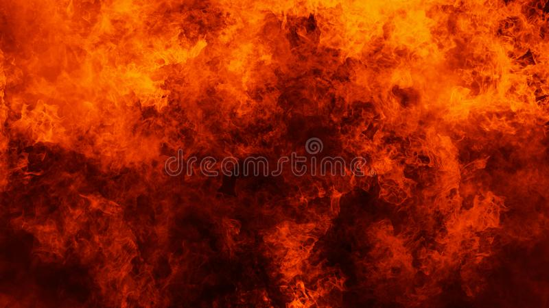 Fire flames texture on isolated black background. Perfect texture overlays for copy space. Design element. Fire flames texture on isolated black background stock images