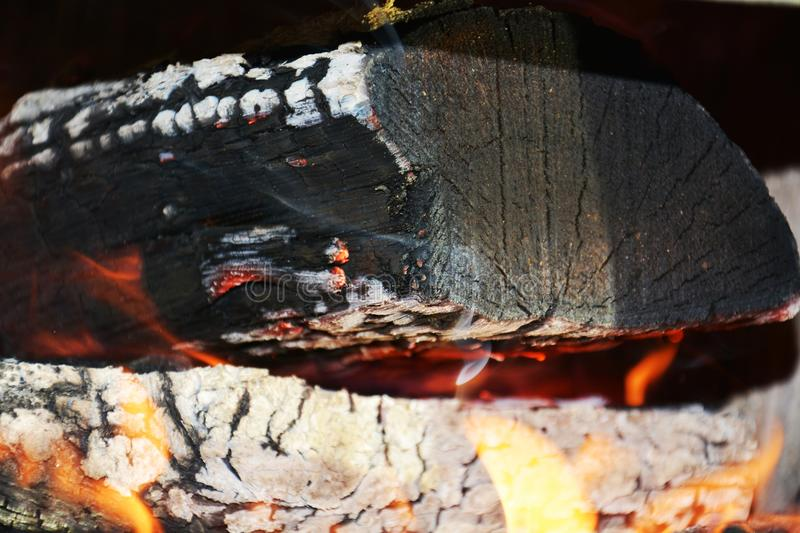 Fire, flames and wooden oven. Wood dark hard logs burning, orange flames and hot temperature stock image
