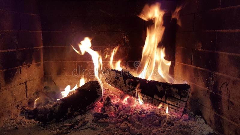 Fire flames woods in fireplace stock images