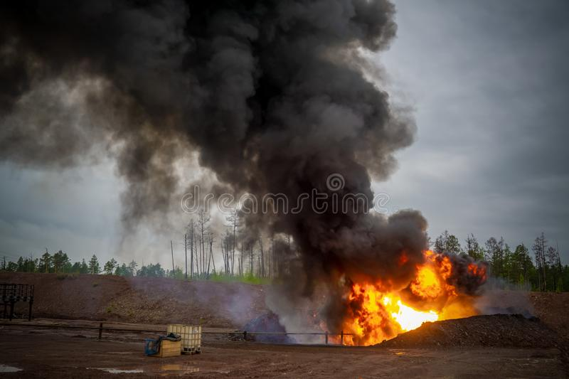 Fire on flare blow out in oil and Gas processing platform and remote platform produced oil, natural gas and liquid condensate. royalty free stock photo
